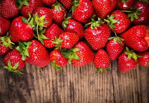 food background with strawberry on wood table