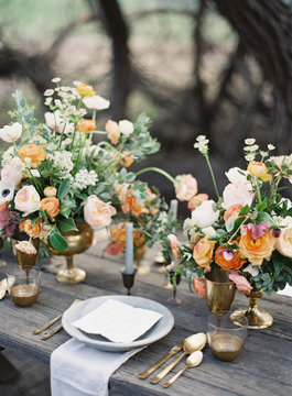 Place setting with fresh flowers on a wooden table