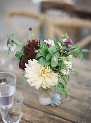 Fresh flowers on wooden table