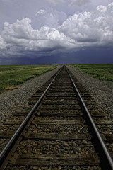 Diminishing perspective of railway track in field landscape