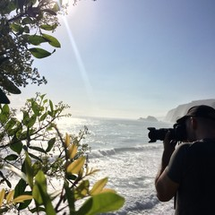 Photographer on Sea Cliff in Hawaii