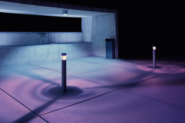 Concrete seating area illuminated with purple light