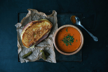 Overhead view of soup and toasted sandwich