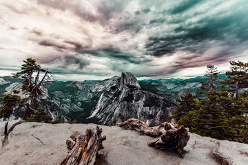 View of rocky mountains and dramatic sky