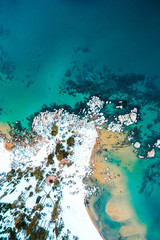Overhead view of snow covered coastline