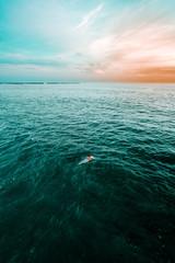 Man on surfboard in ocean