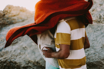 Couple hugging underneath blanket