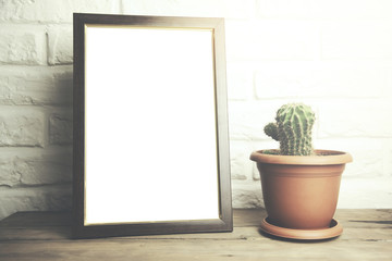 photo frame and  cactus