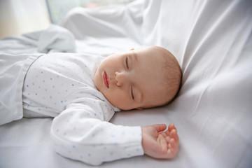 Beautiful sleeping baby in bed