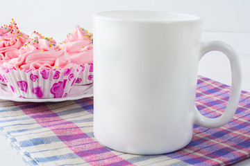 Coffee mug mockup with checkered napkin