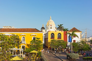 Busy city square near the sea in Cartagena, Colombia. Cartagena old city before the sunset.