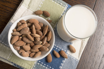 Almond Milk with almonds on table - Overhead