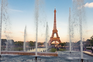 Eiffel Tower (La Tour Eiffel) with fountains. Beautiful sunset l