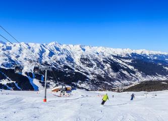 Skiers on the slopes of the ski resort of Meribel. France
