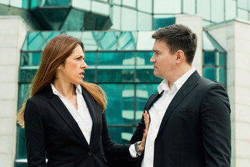 Sexual harassment. Business woman denying approach from her colleague