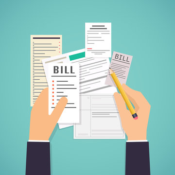 Paying bills. Hands holding bills and pencil. Payment of utility