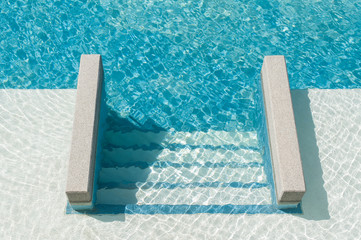 Swimming pool with steps down to the pool
