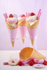 Pink candy ice creams in cones.
