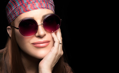 Gorgeous young woman in a head scarf and sunglasses