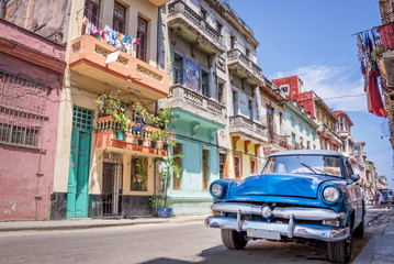 Garden Poster Havana Blue vintage classic american car in a colorful street of Havana, Cuba. Travel and tourism concept.