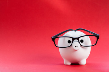 Piggy bank on red background Fototapete