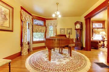 Adorable vintage wood piano in luxurious living room interior wi