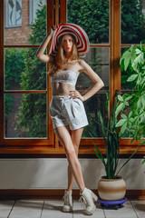 pretty fashion model with big hat