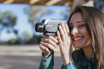 Smiling photographer with old camera