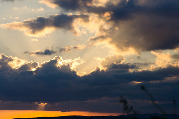 Landscape with clouds on sky at sunset