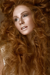 Beautiful Redhead girl with a perfectly creative curls hair and classic make-up. Beauty face.