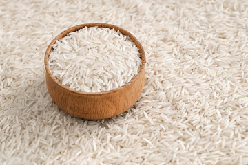 White long rice in wooden bowl.  Close up, high resolution product.