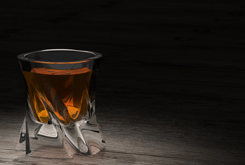 Whiskey on  wooden background with copy-space.