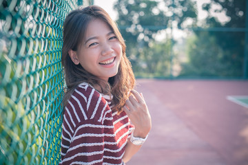 smiling face happiness emotion of asian younger woman with no ma