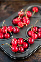 Red organic cherries on a metal tray