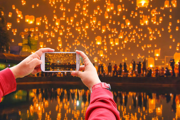 Smartphone photographing Floating lantern at Chiang Mai Province, Asia Thailand