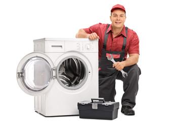 Repairman repairing a washing machine