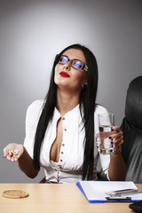 Contemplating Business Woman With Pills And Glass Of Water At De