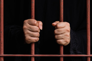 Muslim woman hand in jail