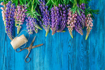 Lupines Flowers on wooden background