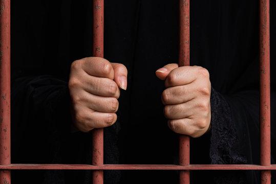 Muslim woman hand in jail