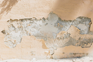 Crumbled plaster on exterior wall