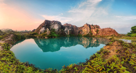 Green lake and reflection of mountain