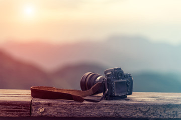 Travel photographer equipment with beautiful landscape on the ba