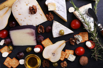 Fototapeta Different kinds of cheese on wooden background