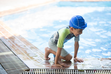 Little boy study in  swimming class with teacher staff