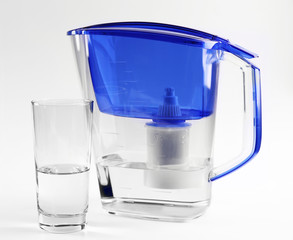 Blue water filter with glass on grey background