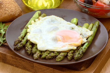 fried egg on green asparagus
