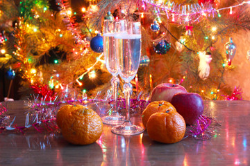 glasses of wine and tangerines on a festive table