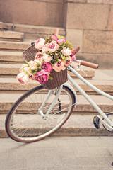 In de dag Fiets vintage girls bicyclewith flowers in basket
