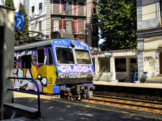 smeared train with graffiti